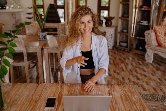 A woman is watching a webinar in her laptop