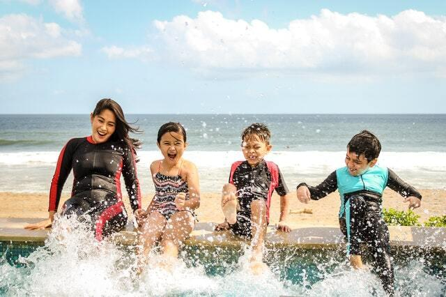children enjoying the pool and the sea