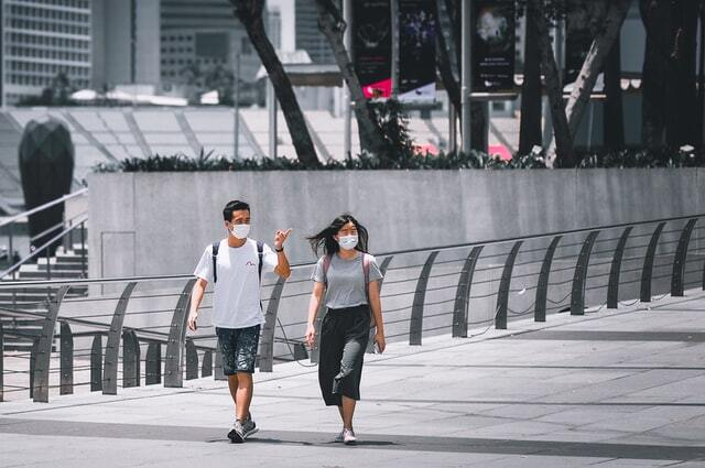 2 people walking with mask